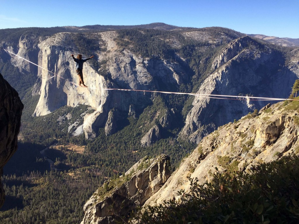 """This Oct. 20, 2019 photo shows Zack Stillwater, of San Diego, """"high-lining"""" at Yosemite National Park's Taft Point. Taft Point provides sweeping views..."""
