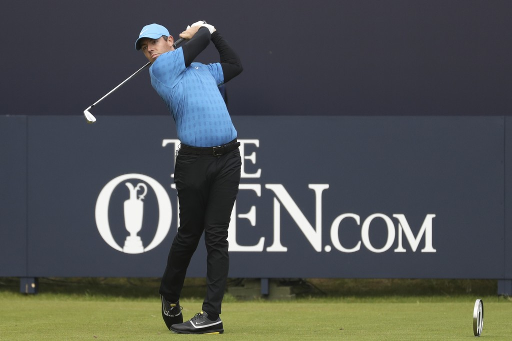 FILE - In this July 18, 2019, file photo, Northern Ireland's Rory McIlroy hits his tee shot on the first hole during the first round of the British Op...