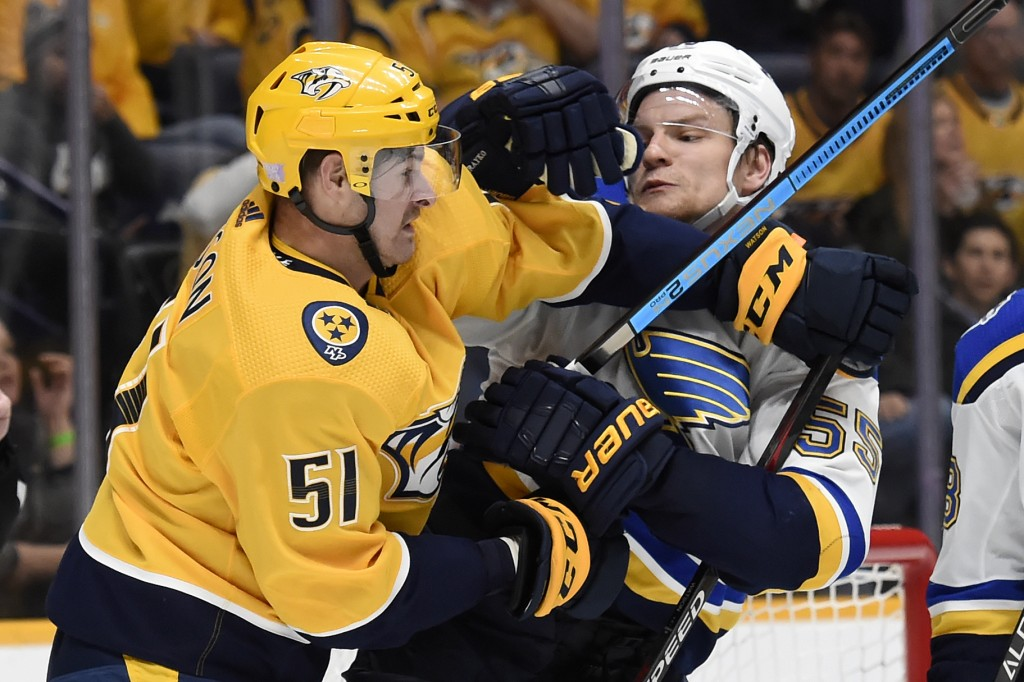 Nashville Predators left wing Austin Watson (51) fights with St. Louis Blues defenseman Colton Parayko (55) during the second period of an NHL hockey ...