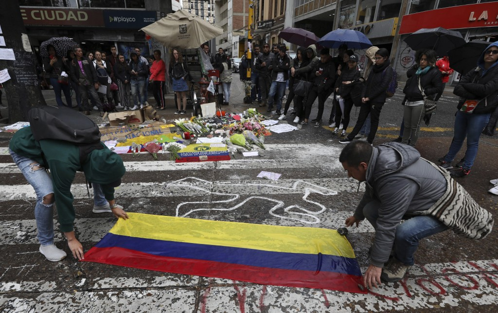 Students place a Colombian national flag at the site where Dilan Cruz was injured during clashes between anti-government protesters and security force...