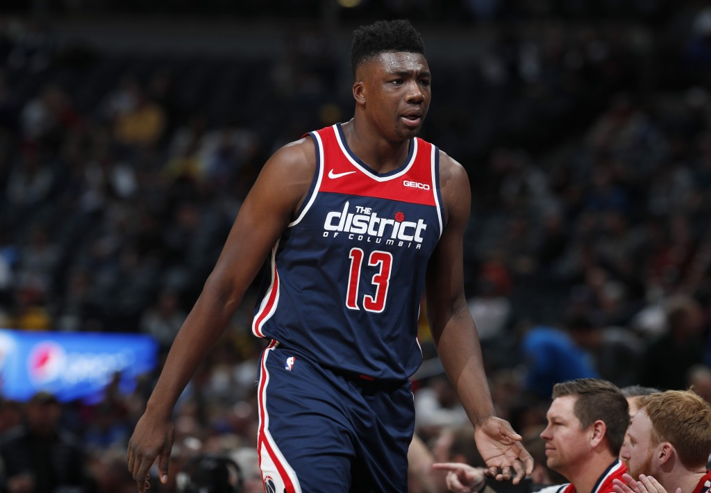 Washington Wizards center Thomas Bryant heads to the bench after drawing two quick fouls against the Denver Nuggets in the first half of an NBA basket...