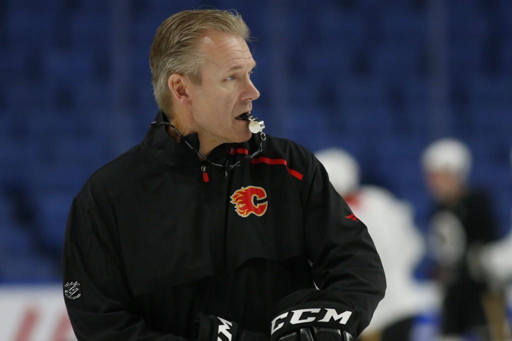 Calgary Flames associate coach Geoff Ward gives instruction during an NHL hockey practice Tuesday, Nov. 26, 2019, in Buffalo, N.Y. Flames general mana...