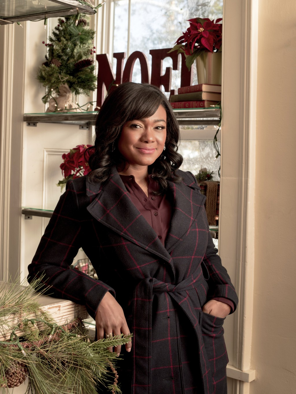 "This image released by Lifetime shows Tatyana Ali, star of the holiday film ""Christmas Hotel,"" airing Dec. 21 on Lifetime. (Lifetime via AP)"