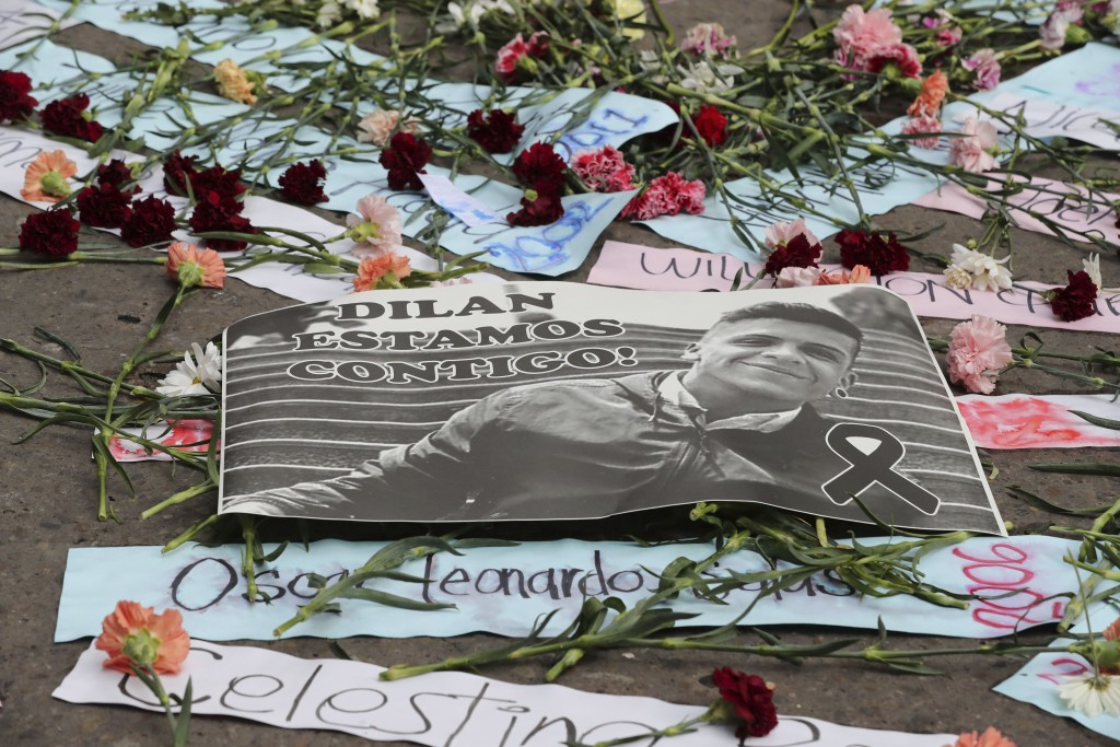 A sign with an image of Dilan Cruz who was injured during clashes between anti-government protesters and police, lies on the ground during a demonstra...