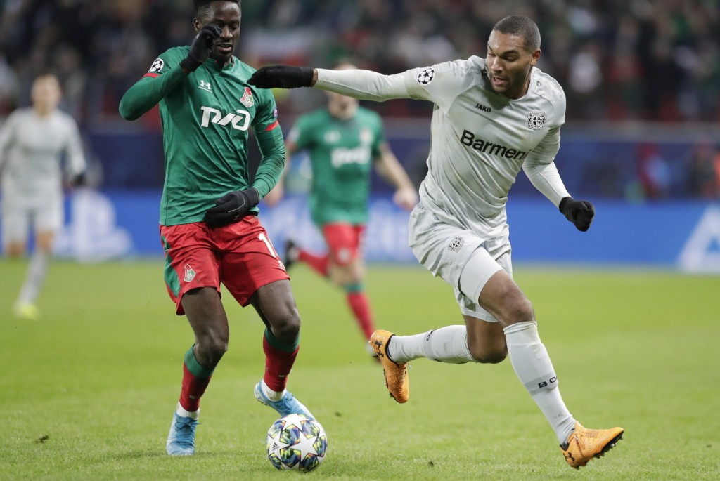 Leverkusen's Jonathan Tah, right, fights for the ball with Lokomotiv's Eder during the Champions League Group D soccer match between Lokomotiv Moscow ...