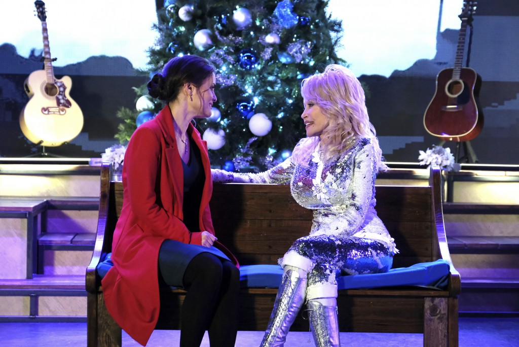 """This image released by Crown Media United States LLC shows Danica McKellar, left, and Dolly Parton in a scene from """"Christmas at Dollywood,"""" airing De..."""