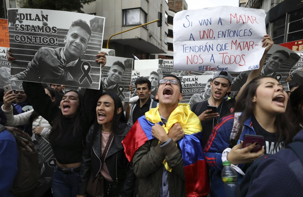 Students sing the national anthem and hold up posters with the image of Dilan Cruz who was injured during clashes between anti-government protesters a...