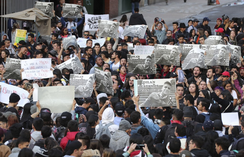 Students hold up posters with the image of Dilan Cruz who was injured during clashes between anti-government protesters and police, during a demonstra...