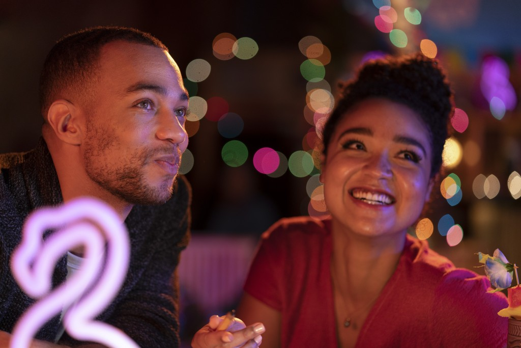"""This image released by Freeform shows Kendrick Sampson, left, and Aisha Dee in a scene from """"Ghosting: The Spirit of Christmas"""" airing December 4 on F..."""