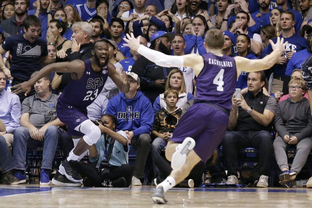 Stephen F. Austin forward Nathan Bain (23) and guard David Kachelries (4) celebrate Bain's game winning basket against Duke in overtime of an NCAA col...