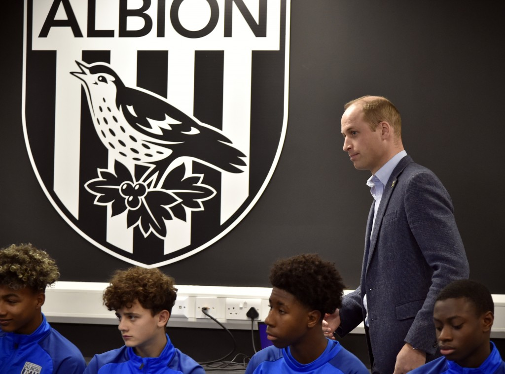 Britain's Prince William meets young players from West Brom's Academy as part of the Heads Up campaign during a visit to West Bromwich Albion Training...