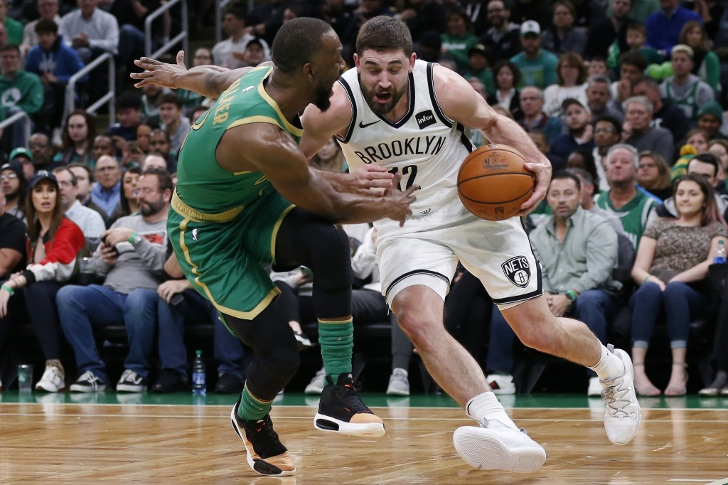 Boston Celtics' Kemba Walker (8) defends against Brooklyn Nets' Joe Harris (12) during the first half of an NBA basketball game in Boston, Wednesday, ...