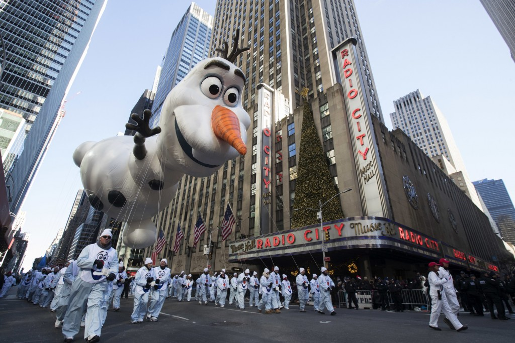 FILE - In this Nov. 22, 2018 file photo, the Olaf balloon floats past Radio City Music Hall during the 92nd annual Macy's Thanksgiving Day Parade in N...