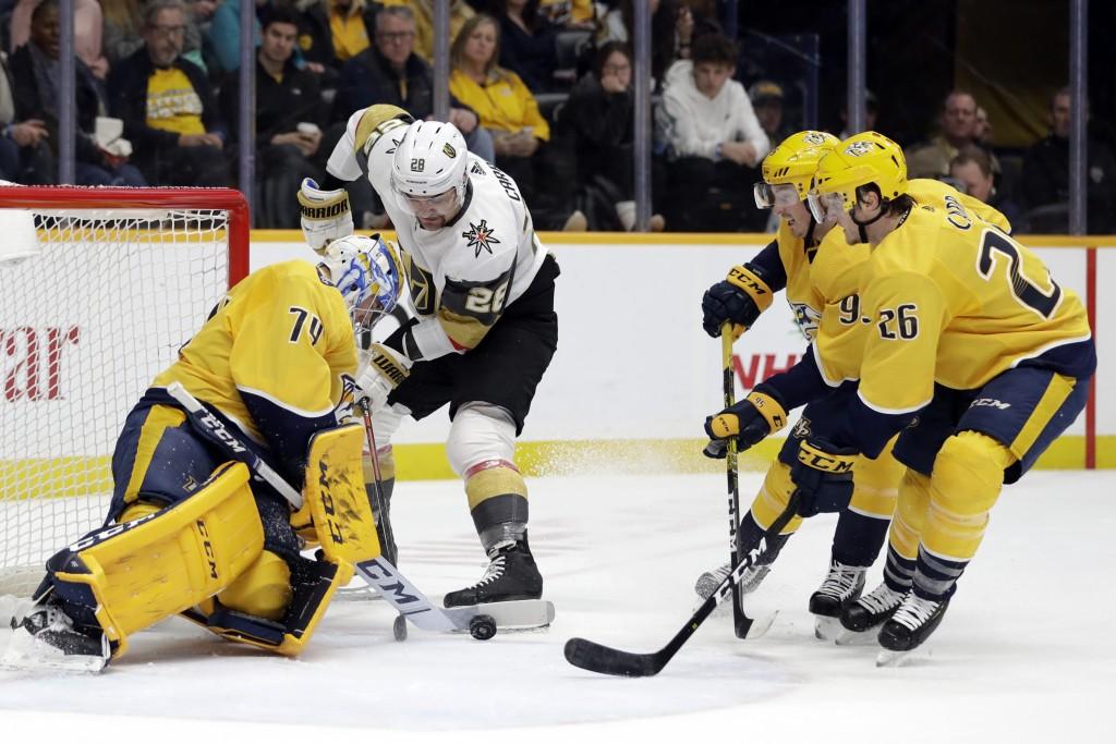 Nashville Predators goaltender Juuse Saros (74), of Finland, blocks a shot by Vegas Golden Knights left wing William Carrier (28) in the first period ...