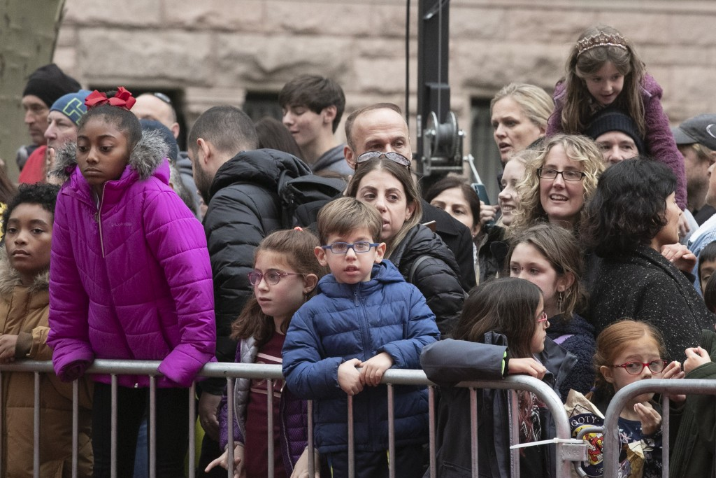Crowds watch as the balloons for the Macy's Thanksgiving Day Parade are inflated, Wednesday, Nov. 27, 2019 in New York. The city's parade on Thursday ...