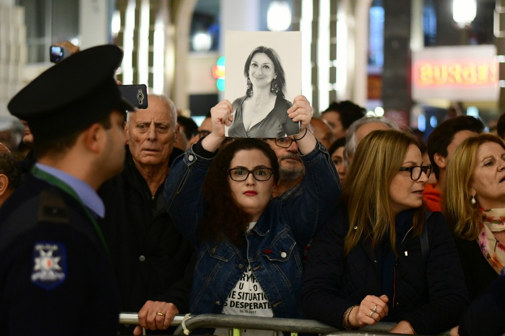 A protestors holds up a pictures of slain journalist Daphne Caruana Galizia during a demonstration outside Malta's prime minister's office in Valletta...
