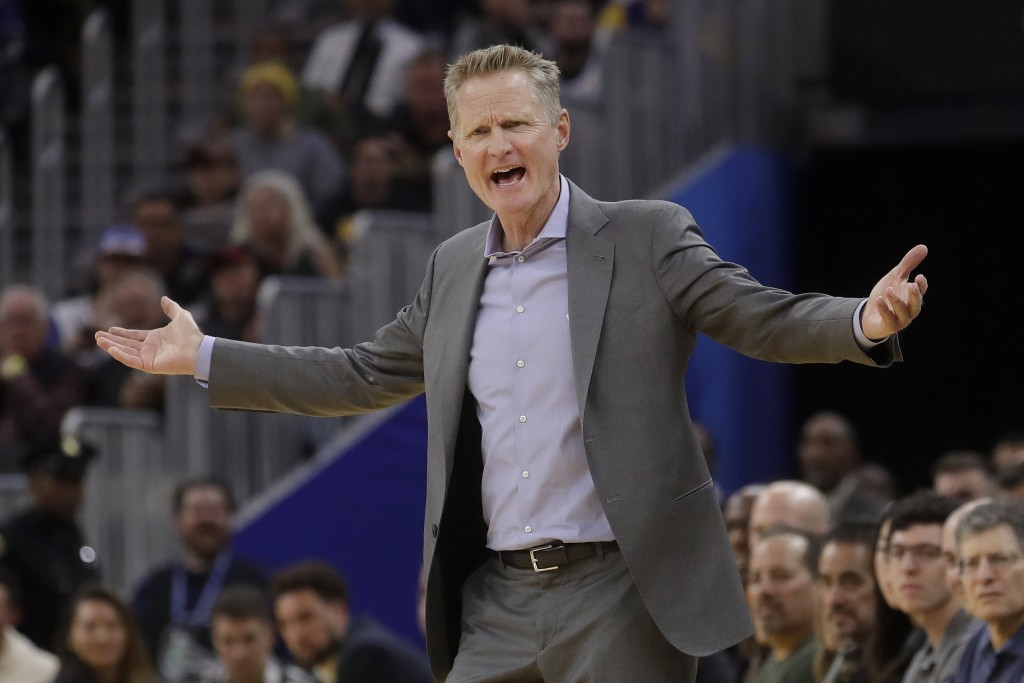 Golden State Warriors coach Steve Kerr gestures during the second half of the team's NBA basketball game against the Chicago Bulls in San Francisco, W...