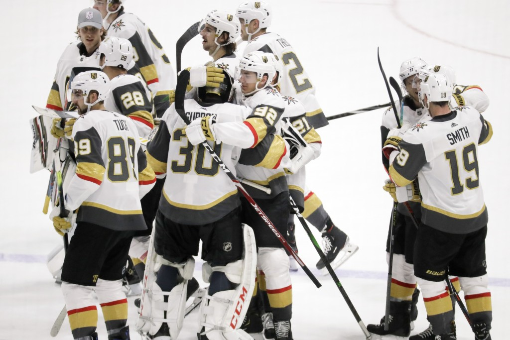 Vegas Golden Knights players celebrate after beating the Nashville Predators 4-3 in overtime of an NHL hockey game Wednesday, Nov. 27, 2019, in Nashvi...