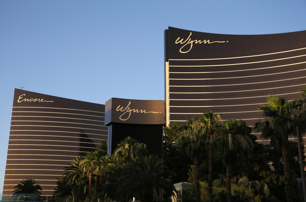 FILE - This June 17, 2014, file photo shows the Wynn Las Vegas and Encore resorts in Las Vegas. Wynn Resorts has agreed to accept $41 million from for...