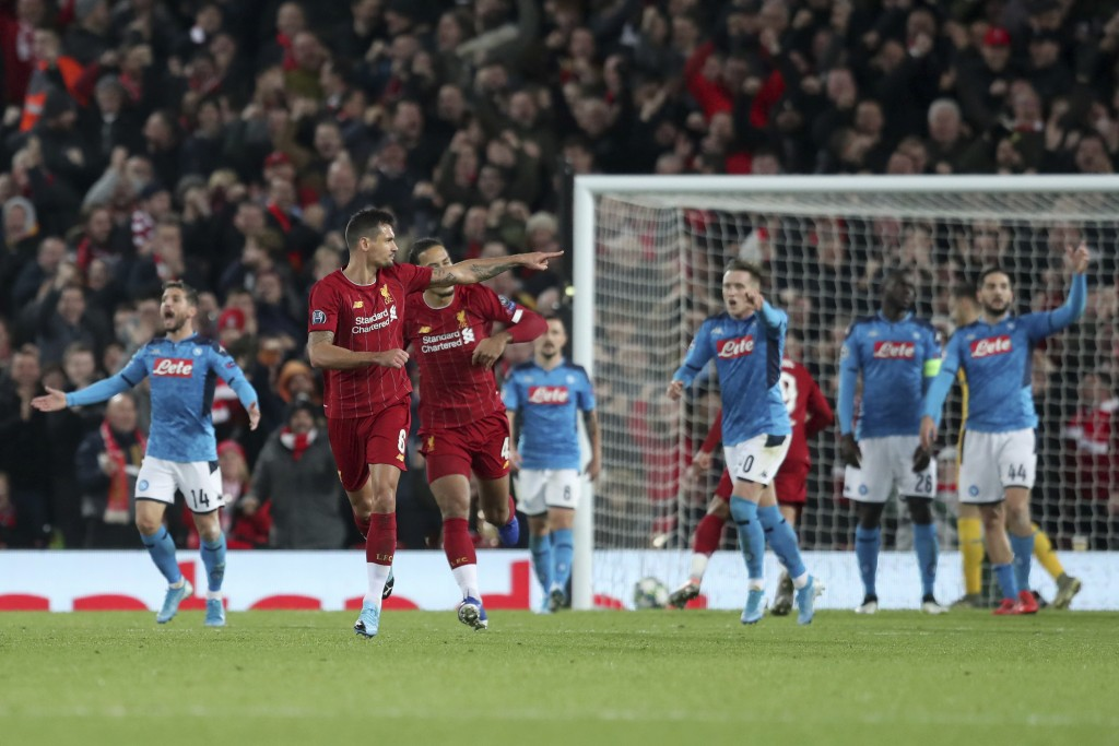 Liverpool's Dejan Lovren, second left, celebrates scoring his side's first goal during the Champions League Group E soccer match between Liverpool and...