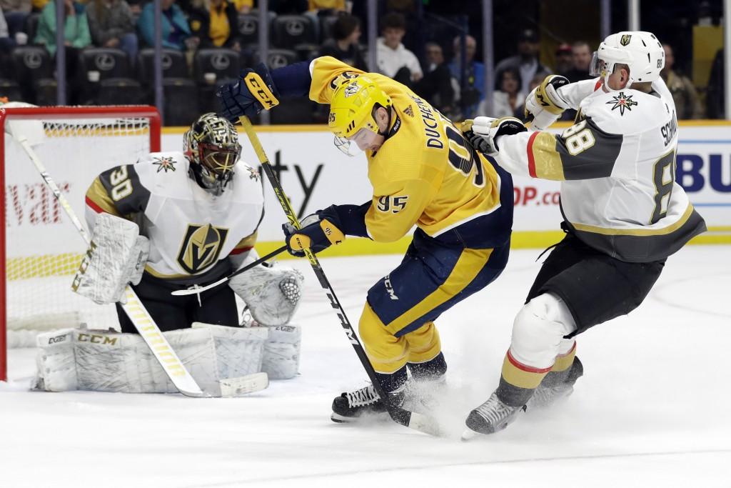 Nashville Predators center Matt Duchene (95) carries the puck between Vegas Golden Knights goaltender Malcolm Subban (30) and defenseman Nate Schmidt ...