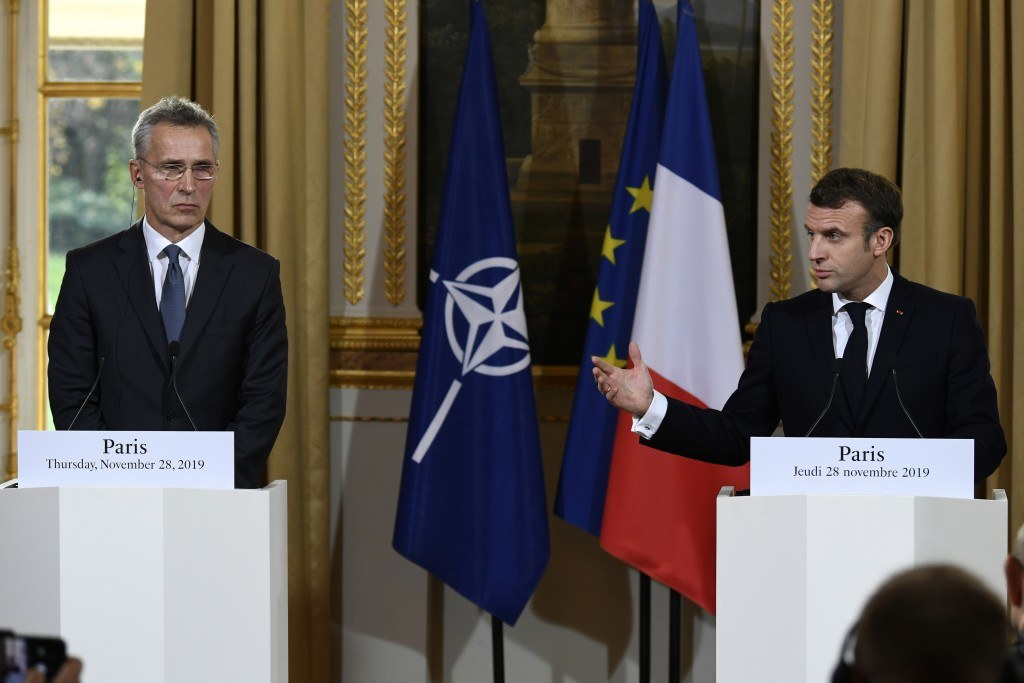 French President Emmanuel Macron, right, and NATO Secretary General Jens Stoltenberg, hold a joint press conference at the Elysee palace, Thursday, No...