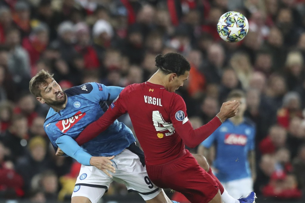Napoli's Fernando Llorente, left, competes for the ball with Liverpool's Virgil van Dijk during the Champions League Group E soccer match between Live...