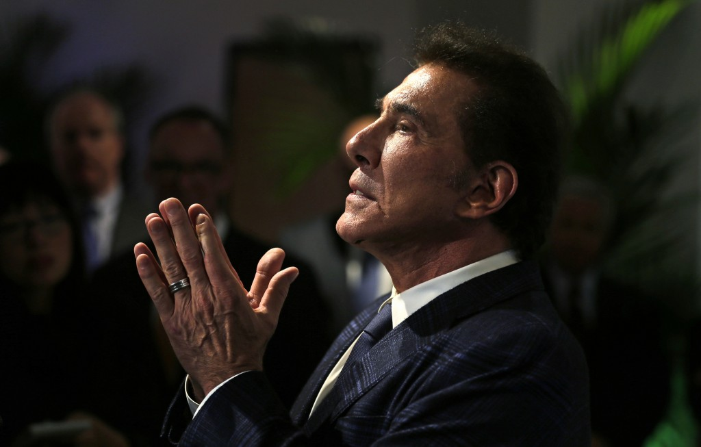 FILE - In this March 15, 2016 file photo, casino mogul Steve Wynn gestures during a news conference in Medford, Mass. Wynn Resorts has agreed to accep...