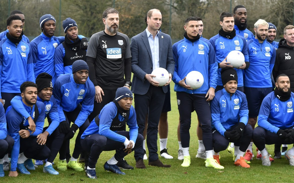 Britain's Prince William meets members of West Bromwich's first team as part of the Heads Up campaign during a visit to West Bromwich Albion Training ...