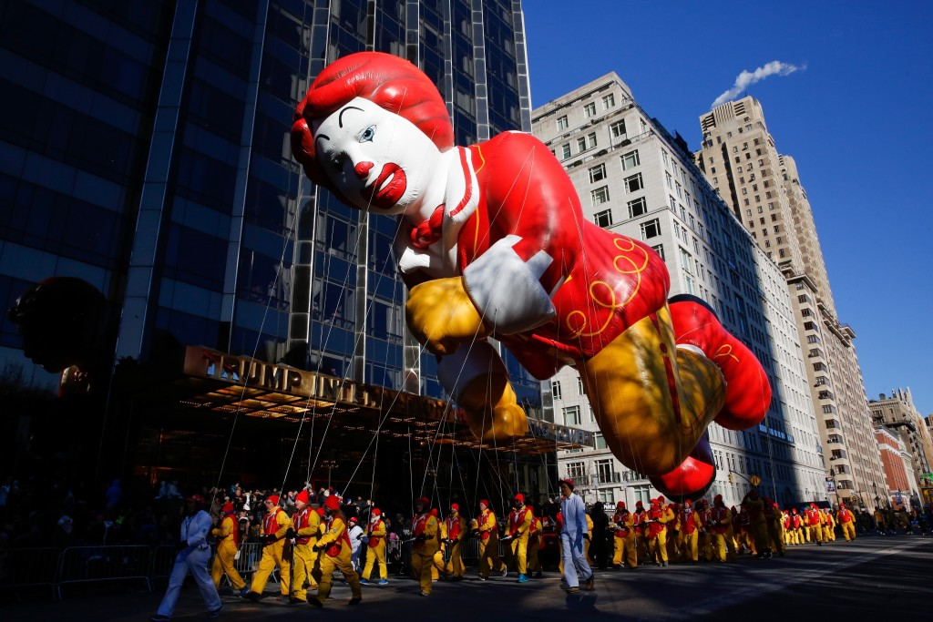 FILE - In this Nov. 22, 2018 file photo, the Ronald McDonald balloon passes by windows of a building on Central Park West during the 92nd annual Macy'...