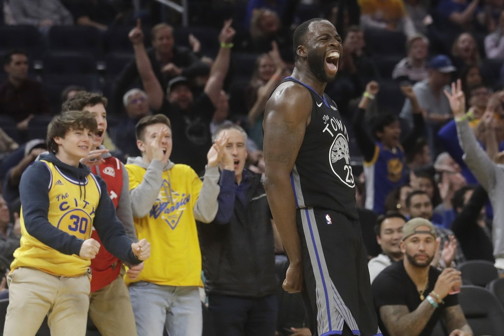 Golden State Warriors forward Draymond Green (23) celebrates after scoring against the Chicago Bulls during the second half of an NBA basketball game ...