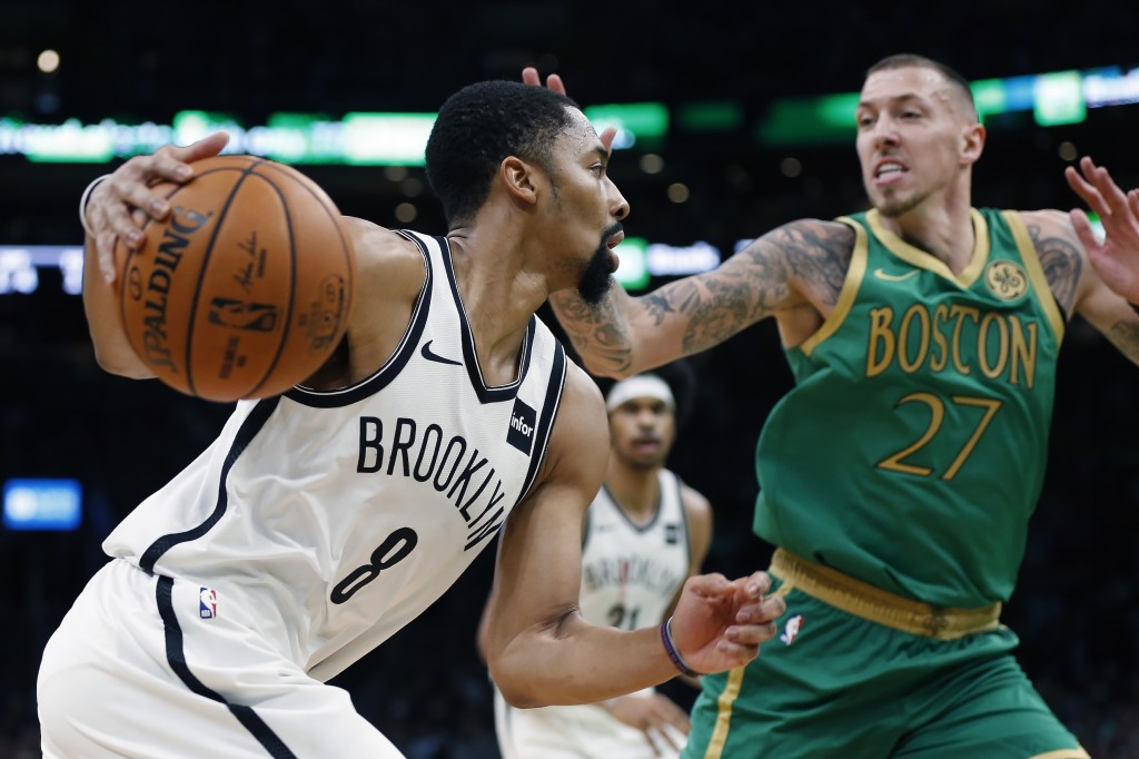 Brooklyn Nets' Spencer Dinwiddie (8) drives past Boston Celtics' Daniel Theis (27) during the first half of an NBA basketball game in Boston, Wednesda...