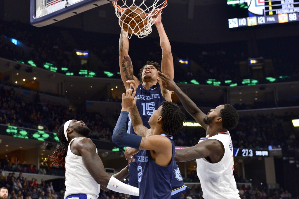 Memphis Grizzlies forward Brandon Clarke (15) dunks as Los Angeles Clippers forwards Montrezl Harrell, left, and JaMychal Green and Grizzlies guard Ja...