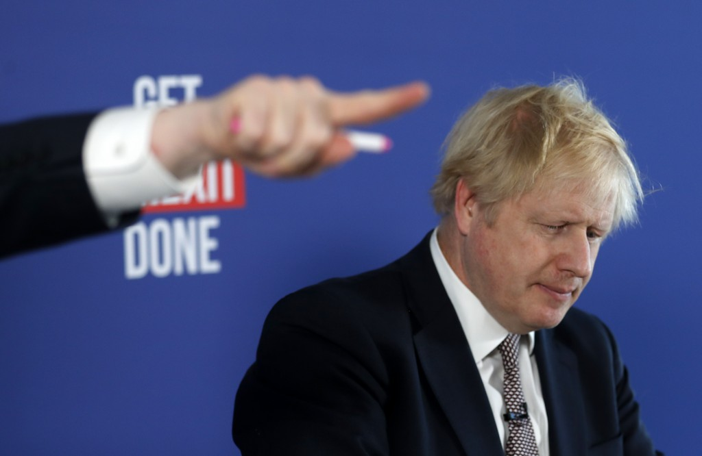 Chancellor of the Duchy of Lancaster Michael Gove, left, gestures during a media conference with Britain's Prime Minister Boris Johnson, right, in Lon...