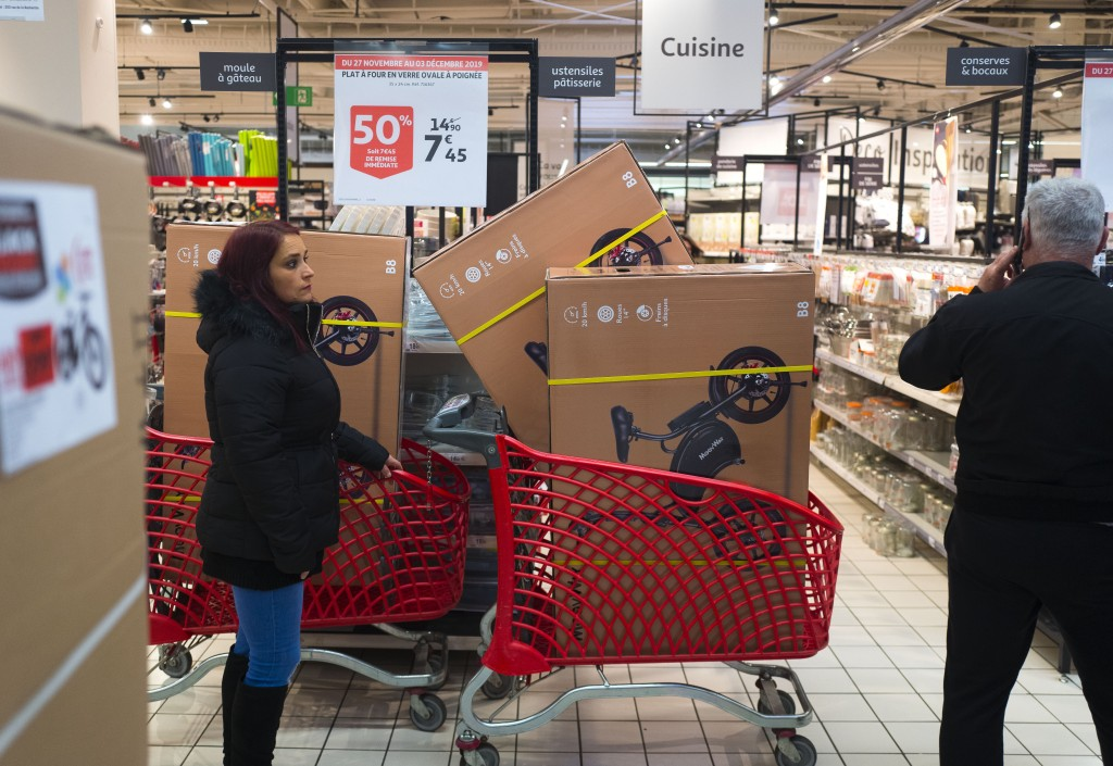 A shopper with large ticket goods is seen during the opening of an Auchan general store, on Black Friday, Nov 29, 2019, in Englos, northern France.