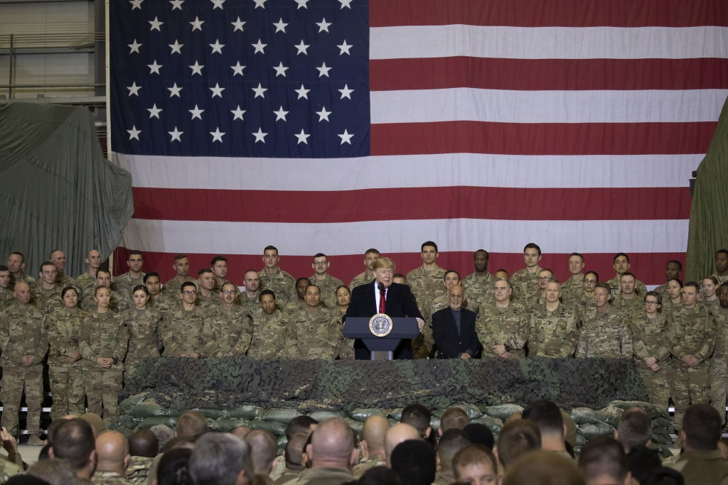 President Donald Trump addresses members of the military during a surprise Thanksgiving Day visit, Thursday, Nov. 28, 2019, at Bagram Air Field, Afgha...