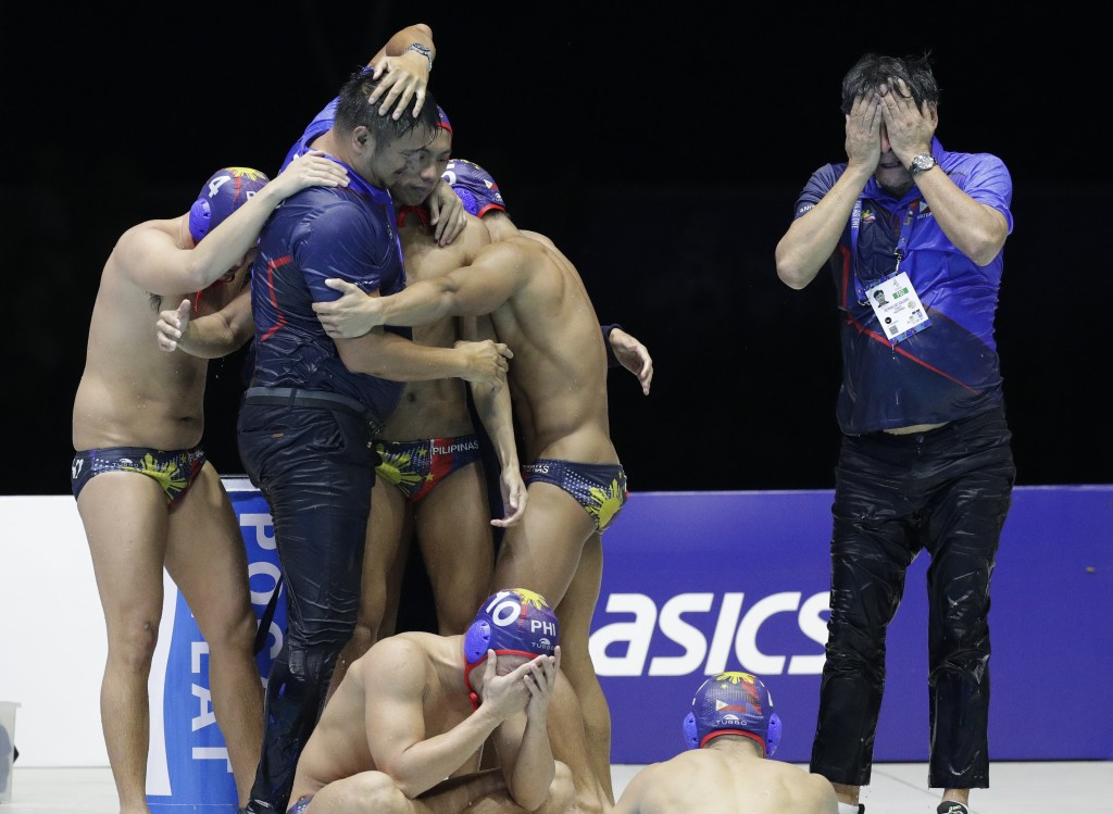 Philippines water polo team react after their game against Singapore at the 30th South East Asian Games in New Clark City, Tarlac province, northern P...