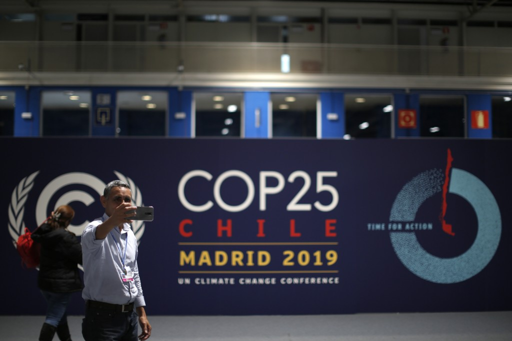 A participant takes a selfie ahead of the Climate Summit COP25 in Madrid, Spain, Friday, Nov. 29, 2019. The Climate Summit COP25 runs between 2 Dec. u...