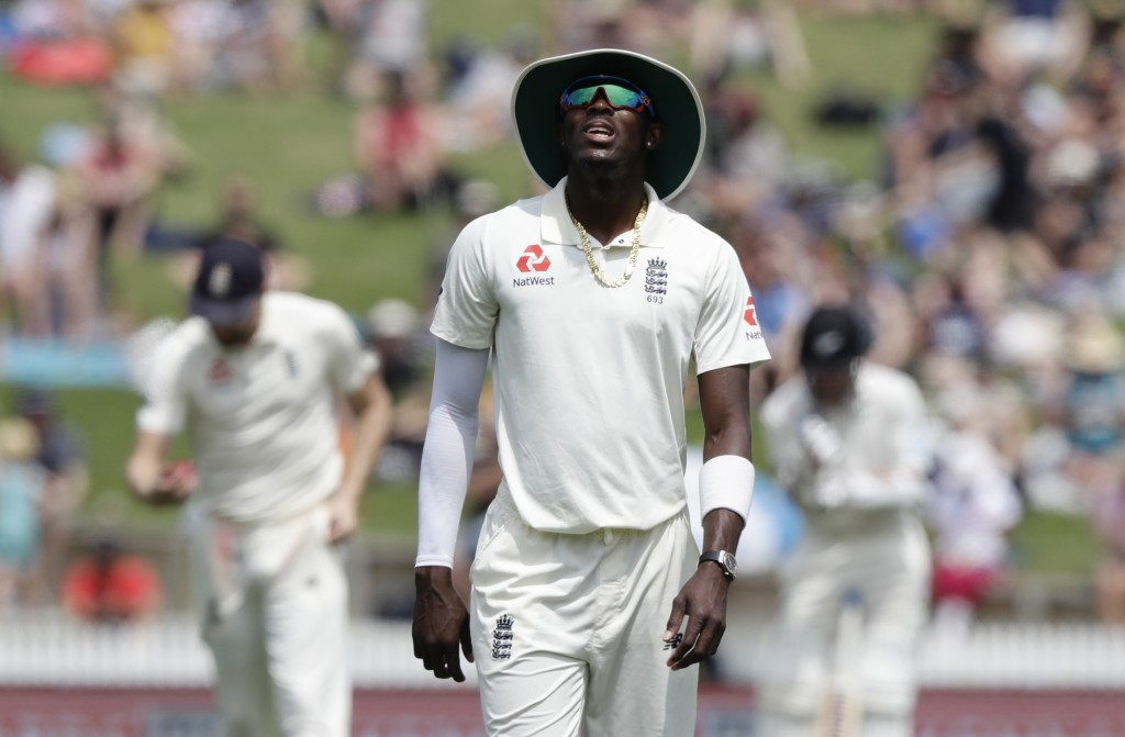 England's Jofra Archer reacts while fielding during play on day two of the second cricket test between England and New Zealand at Seddon Park in Hamil...