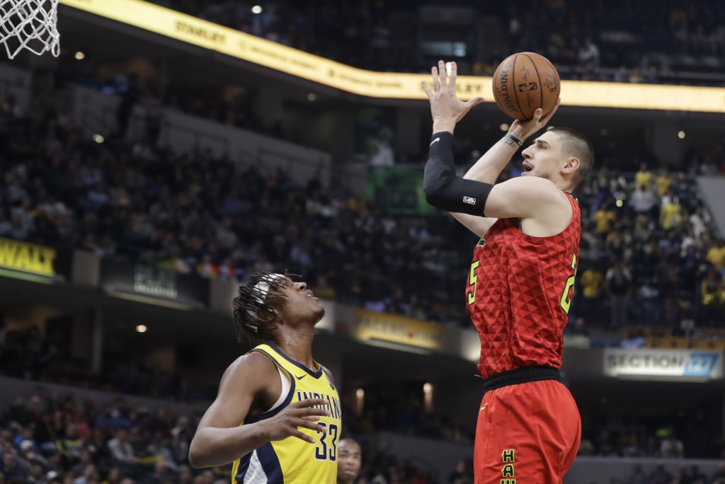 Atlanta Hawks' Alex Len (25) shoots over Indiana Pacers' Myles Turner (33) during the first half of an NBA basketball game, Friday, Nov. 29, 2019, in ...