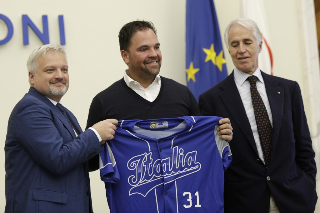 Hall of Fame catcher Mike Piazza shows his jersey during his presentation as Italy's national baseball team coach, at the Italian Olympic Committee he...