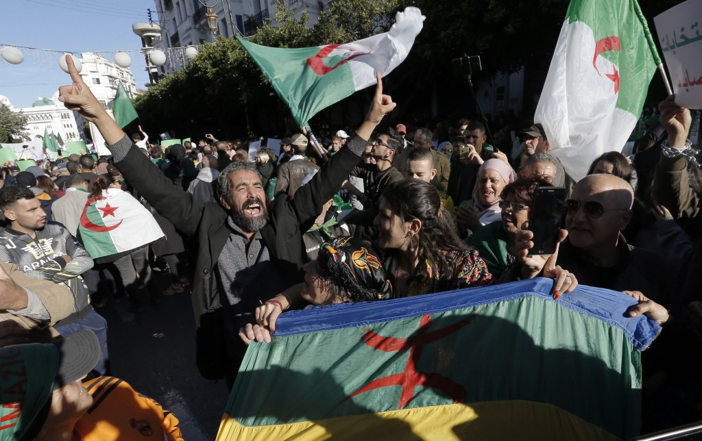 Algerian demonstrators take to the streets in to protest against the government and the upcoming presidential elections, inAlgiers, Algeria, Friday, N...