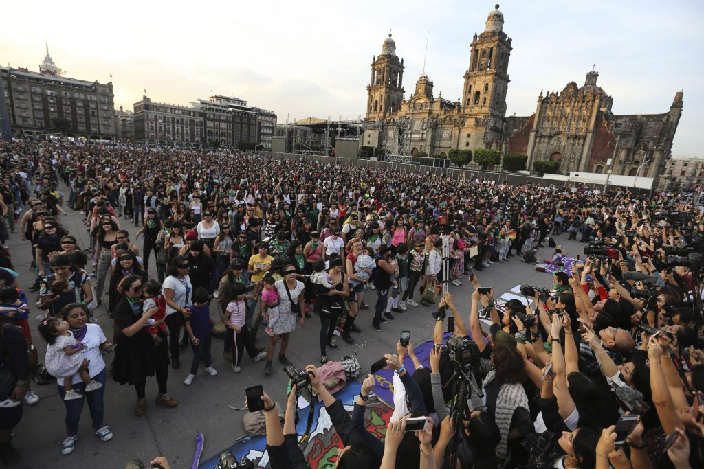 Feminist activists protest at the Zocalo square in Mexico City, Friday, Nov. 29, 2019. According the to the federal government  there were 3,662 gende...