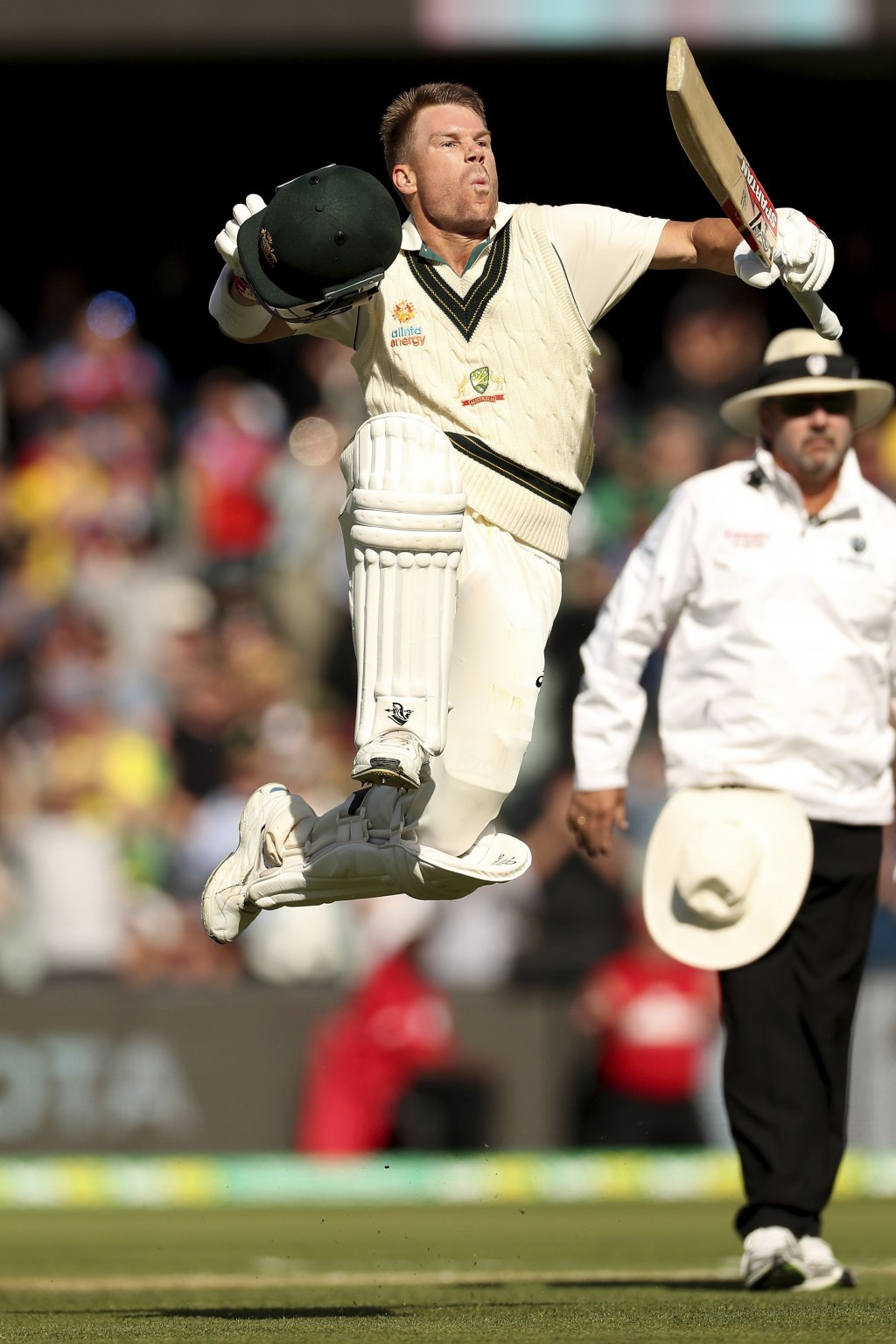 Australia's David Warner celebrates his 300 during their cricket test match against Pakistan in Adelaide, Saturday, Nov. 30, 2019. (AP Photo/James Els...