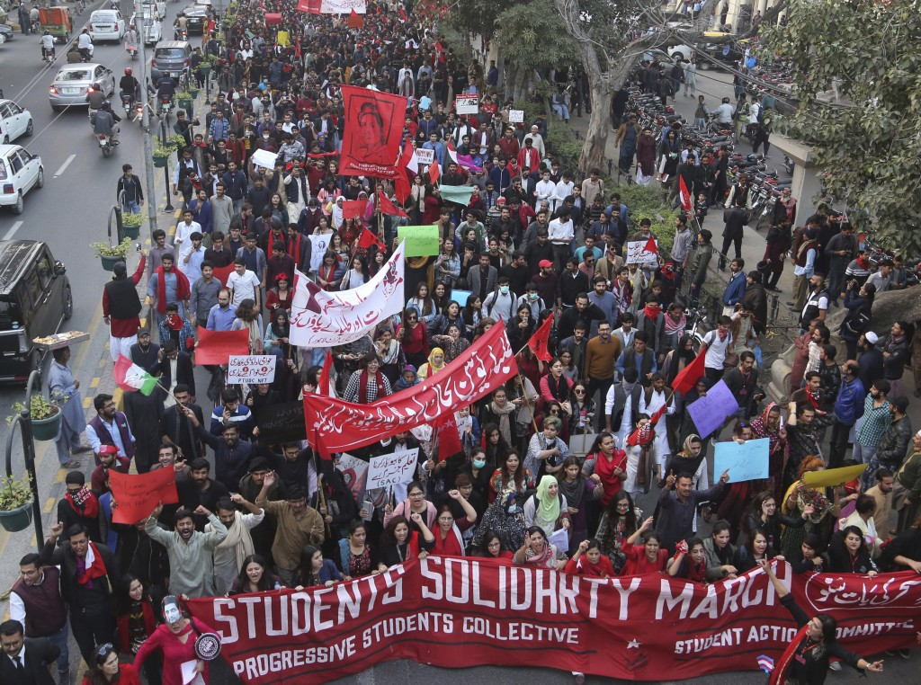 Pakistani students and civil society activists rally against ban on students' unions in Lahore, Pakistan, Friday, Nov. 29, 2019. Students backed by ri...
