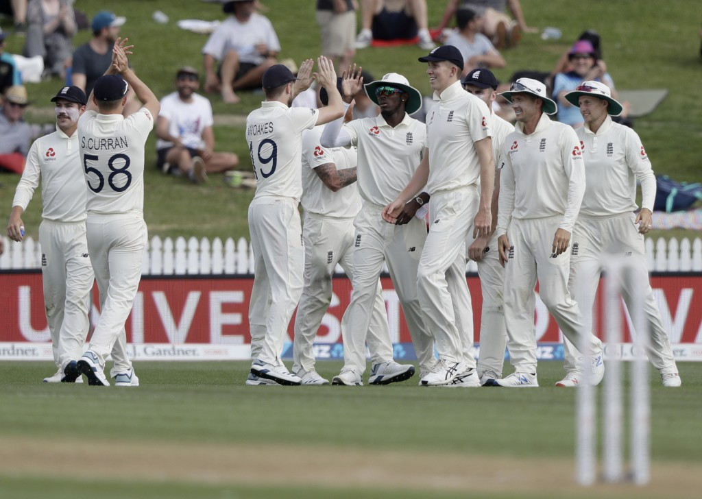England's Jofra Archer, center, is congratulated by teammates after taking a catch to dismiss New Zealand's Daryl Mitchell during play on day two of t...