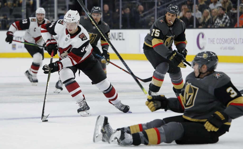 Arizona Coyotes center Carl Soderberg (34) skates around Vegas Golden Knights defenseman Brayden McNabb (3) during the first period of an NHL hockey g...