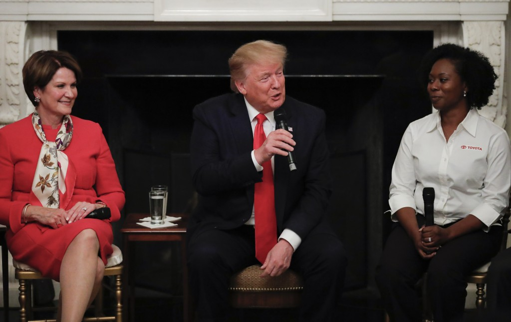 FILE - In this July 25, 2019, file photo, President Donald Trump, joined by Shameka Whaley Green of Toyota, right, and Marillyn Hewson, Chairman, Pres...
