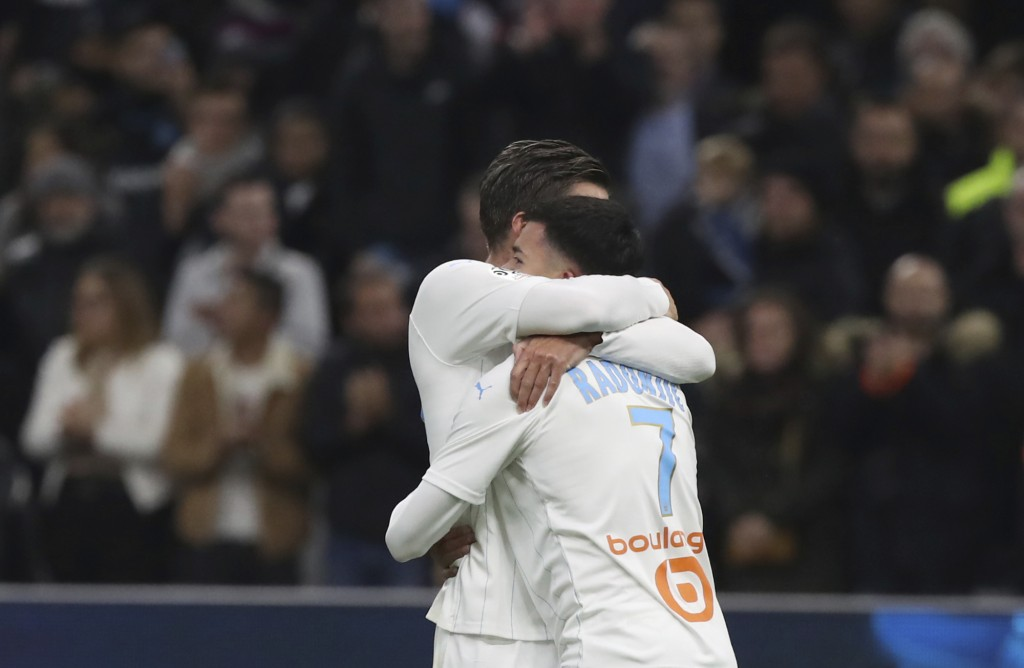 Marseille's Kevin Strootman, left, and Marseille's Nemanja Radonjic celebrate their victory after the French League One soccer match between Marseille...