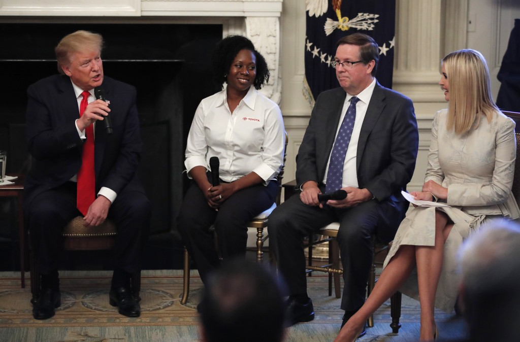 FILE - In this July 25, 2019, file photo, President Donald Trump, from left, joined by Shameka Whaley Green of Toyota, Jim Lentz, CEO of Toyota North ...